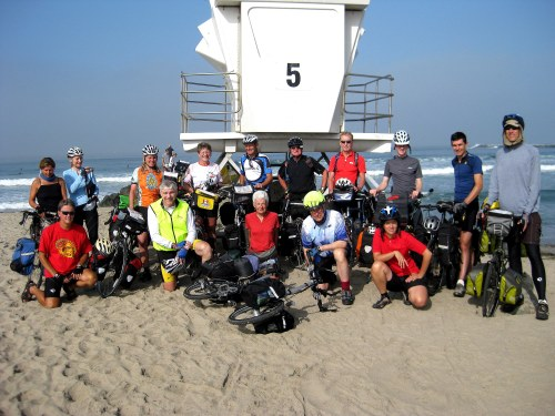 A group photo after the ritual dipping of the rear wheel in the Pacific Ocean