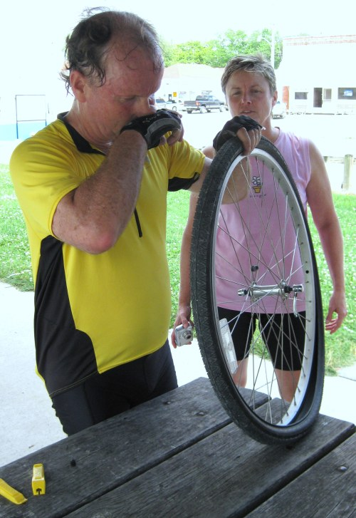 Jim Finney fixes a flat on the first day as Laura offers advice