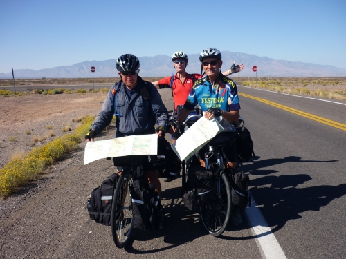 Check of the elevation profile on the road to Three Way, Ariz. From left: Jim, Gerben and Derrik