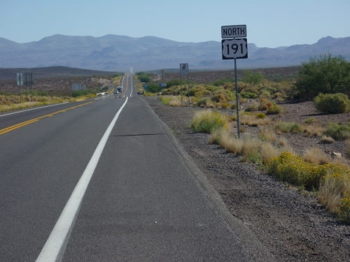 The road goes on forever in the high desert of Arizona