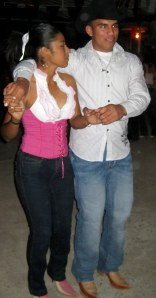 A handsome young couple dance at the Santa Teresa fall festival