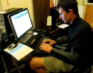 Reg Prentice working on his blog at a KOA campsite