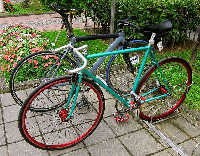 Colorful fixies in bike rack
