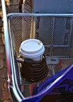 A cable lock provides a handy holder for a coffee container