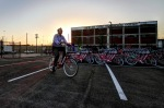 At dawn, volunteers began arriving to deliver bike-share bikes to docking stations throughout Fort Worth