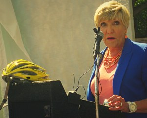 Fort Worth's bicycling mayor, Betsy Price, addresses the assembled volunteers
