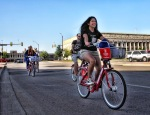 Volunteers ride past Fort Worth's main post office on the way to their designated docking stations