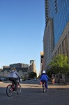 Volunteers ride past the Omni Hotel on their way to downtown docking stations