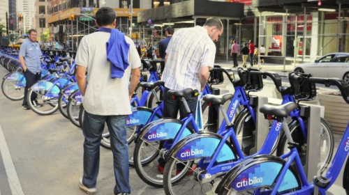 New Yorkers checking out the new bike-share system. Photo by Bill Cunninghtam, The New York Times