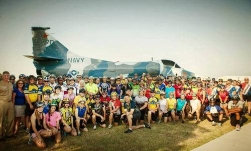 Group shot of Tour de Fort Worth riders at Naval Air Station Fort Worth Joint Reserve Base, July 13