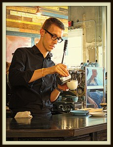 A barista makes a latte at Oak Cliff Coffee Roasters, Dallas