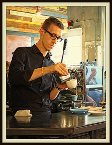 A barista makes a latte at Oak Cliff Coffee Roasters, Dallas