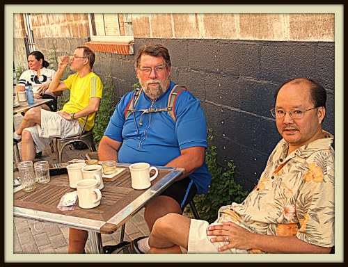 Fellow cyclists Jeff Sailer, center, and Scott Nishimura, right,  at Oak Cliff Coffee roasters
